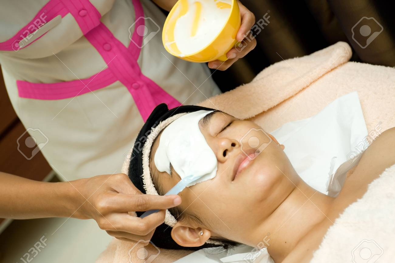 mask cream being applied on woman face during facial treatment Stock Photo - 5998088