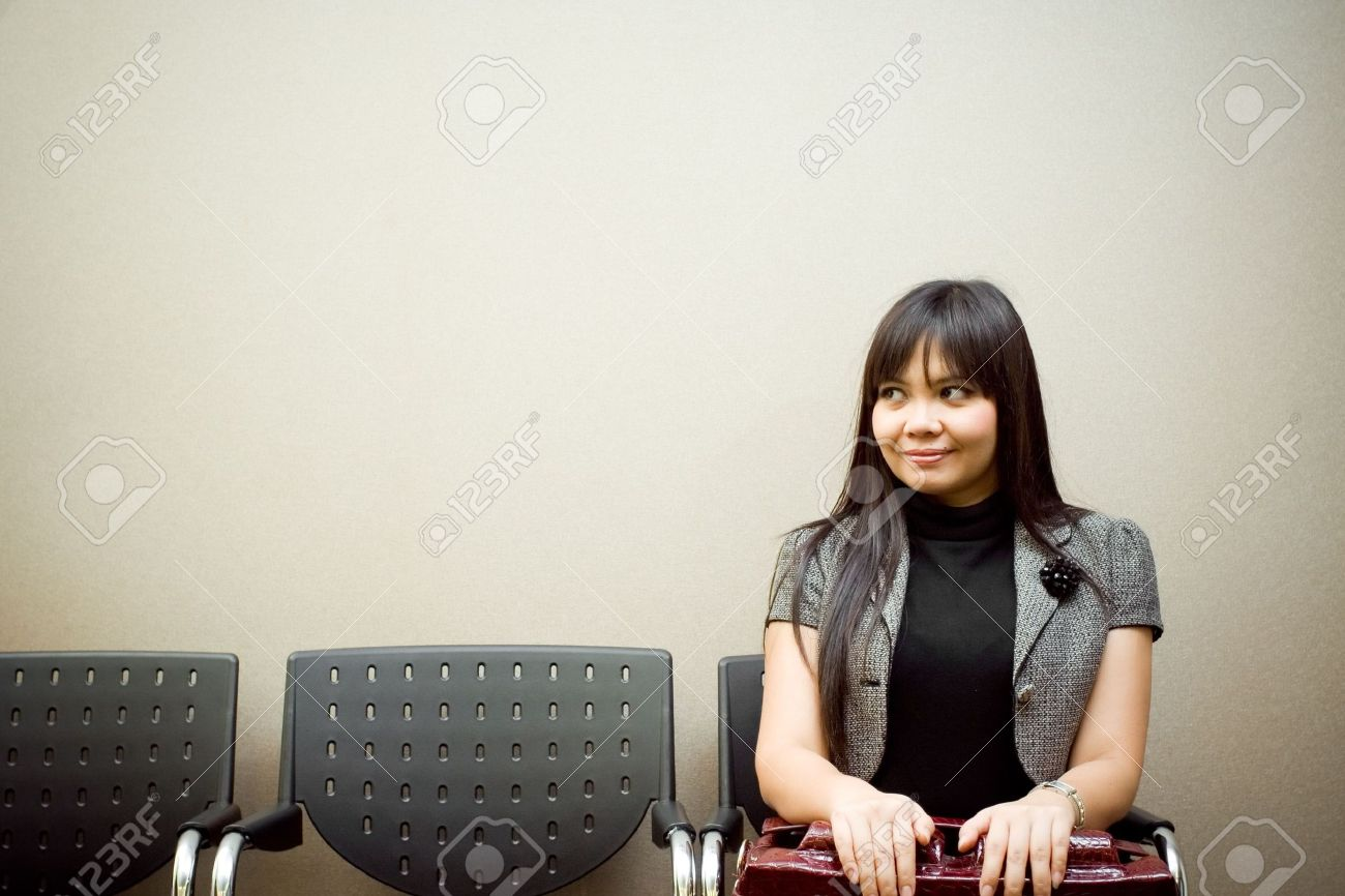 last job seeker sitting alone in a waiting room for an interview Stock Photo - 6328810