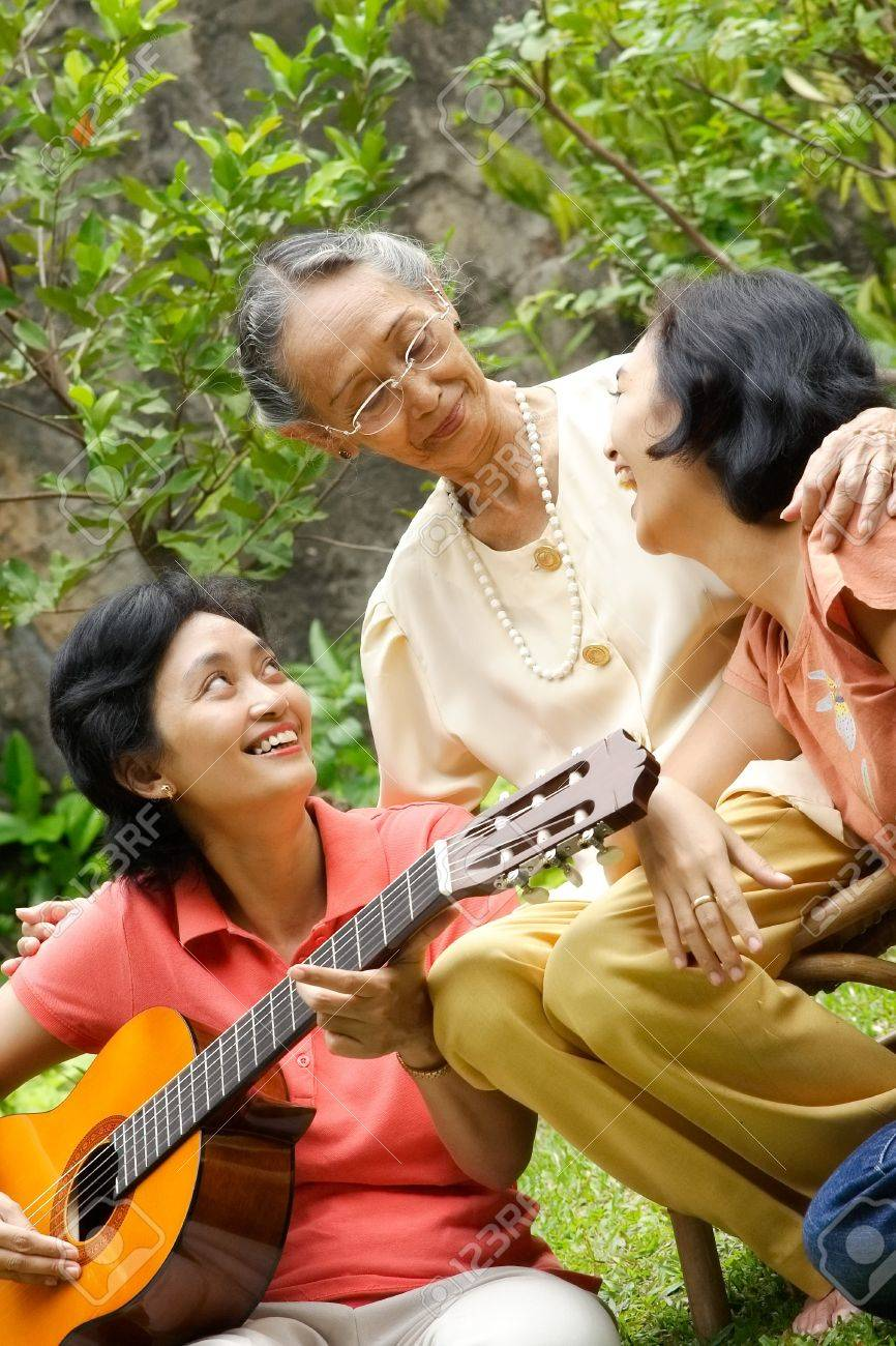 Asian family portrait of old mother relaxing together with her daughter Stock Photo - 7744688