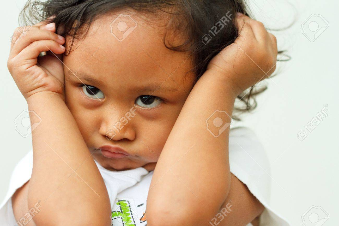 expression of asian ethnic little girl in a bad mood Stock Photo - 10065167