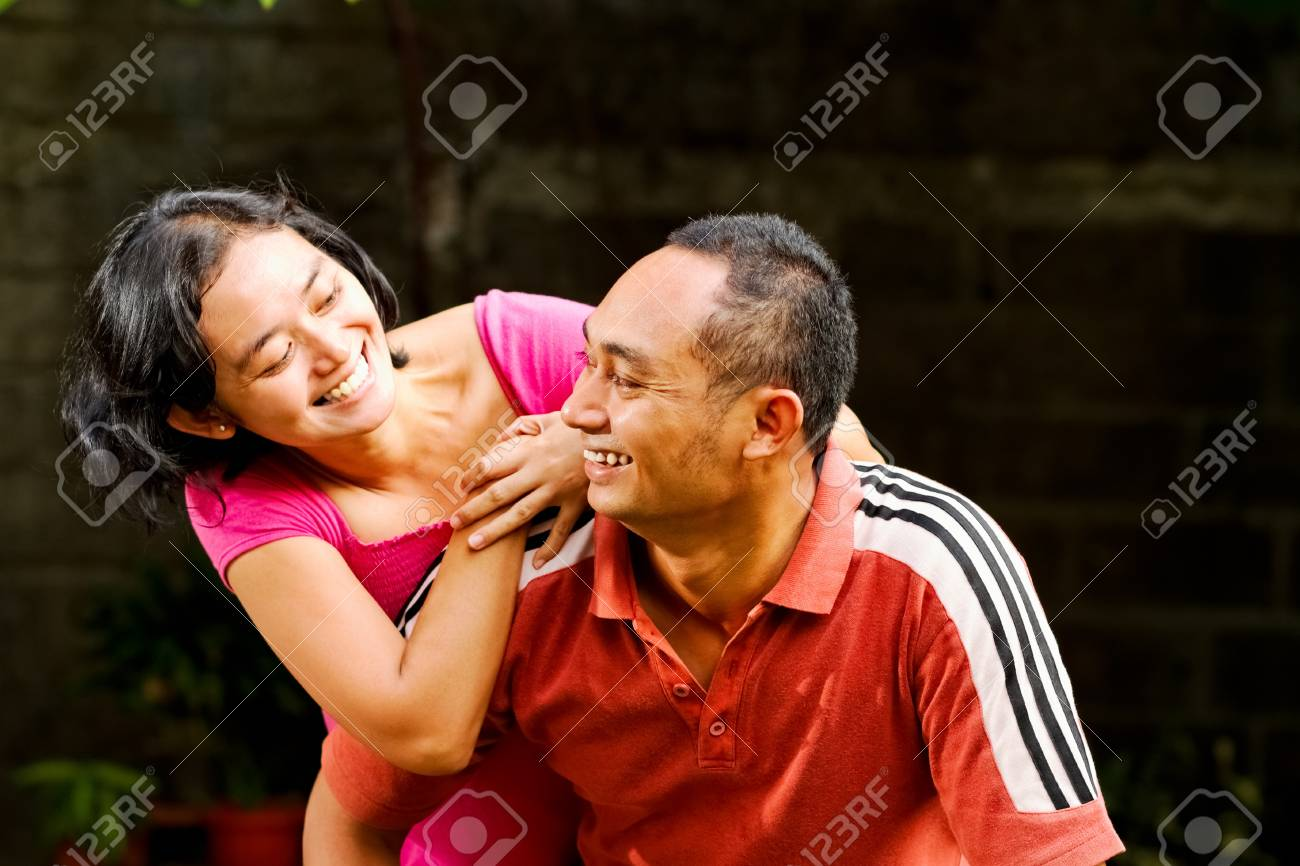 portrait of cheerful asian ethnic young man and woman Stock Photo - 12641496