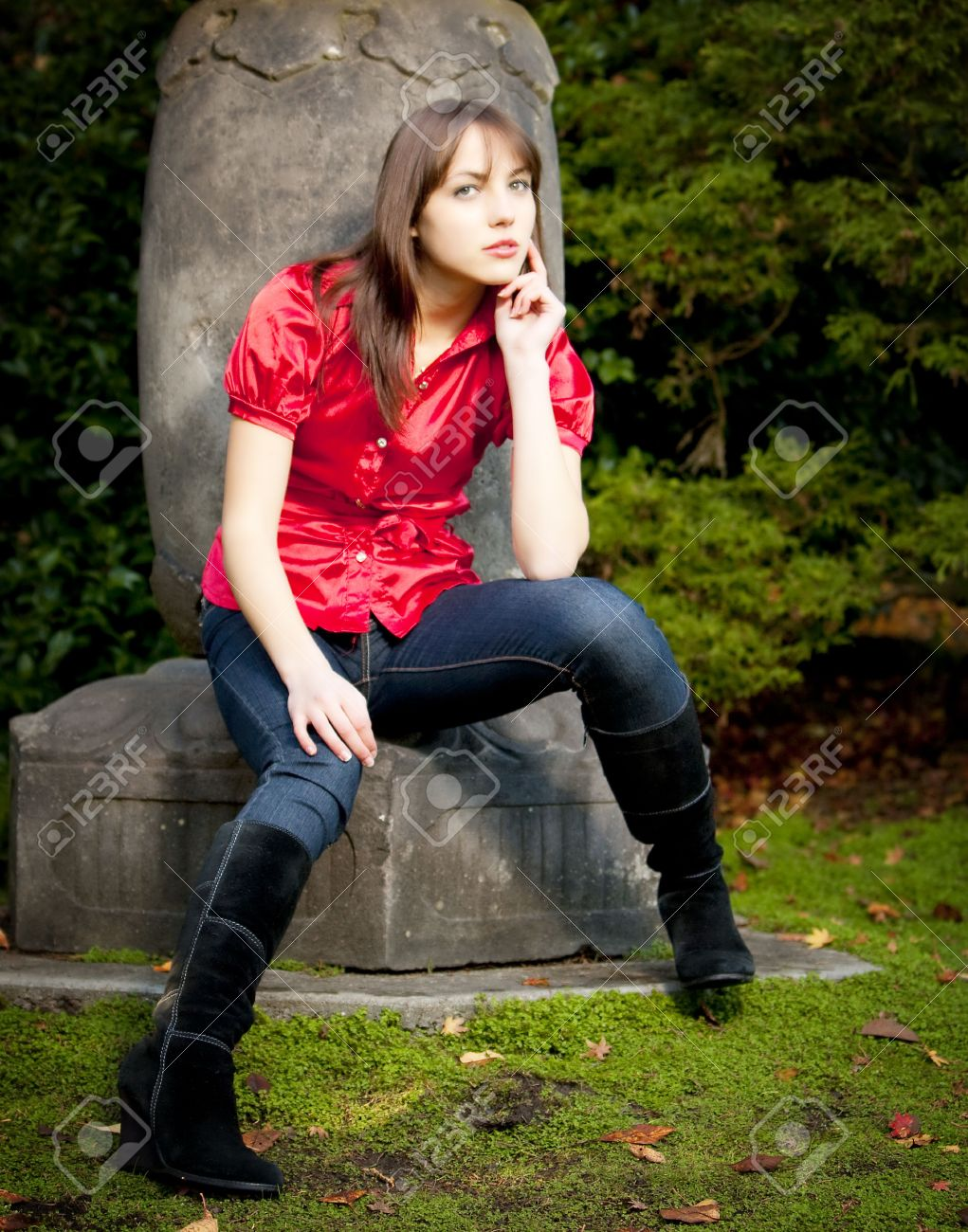 A Young Attractive Caucasian Girl In Red Shirt And Blue Jeans ...