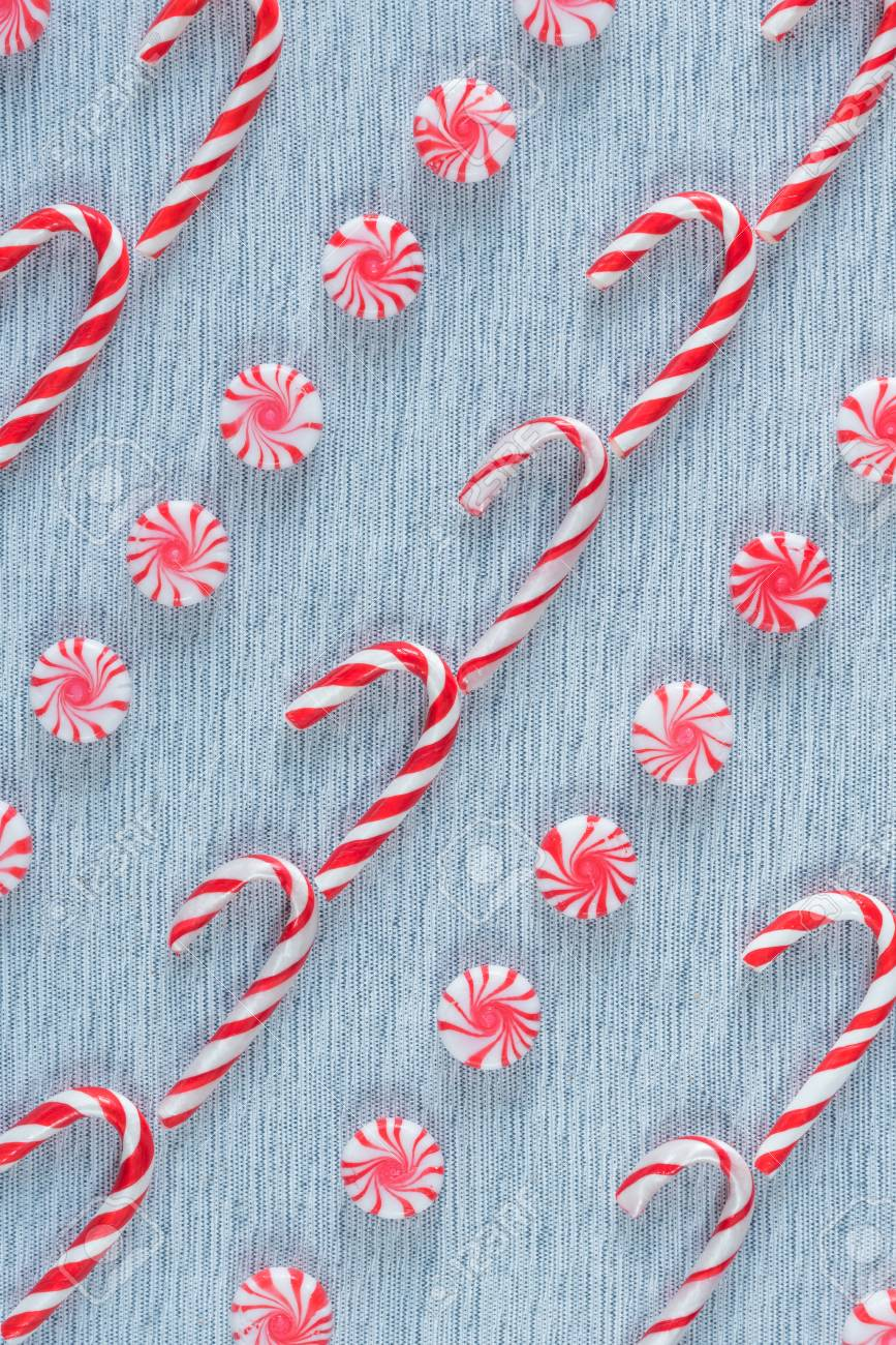 Diagonal Rows Of Christmas Candy Canes And Peppermint Swirl Candies