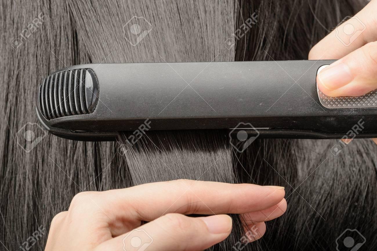 straighten hair - 39551699