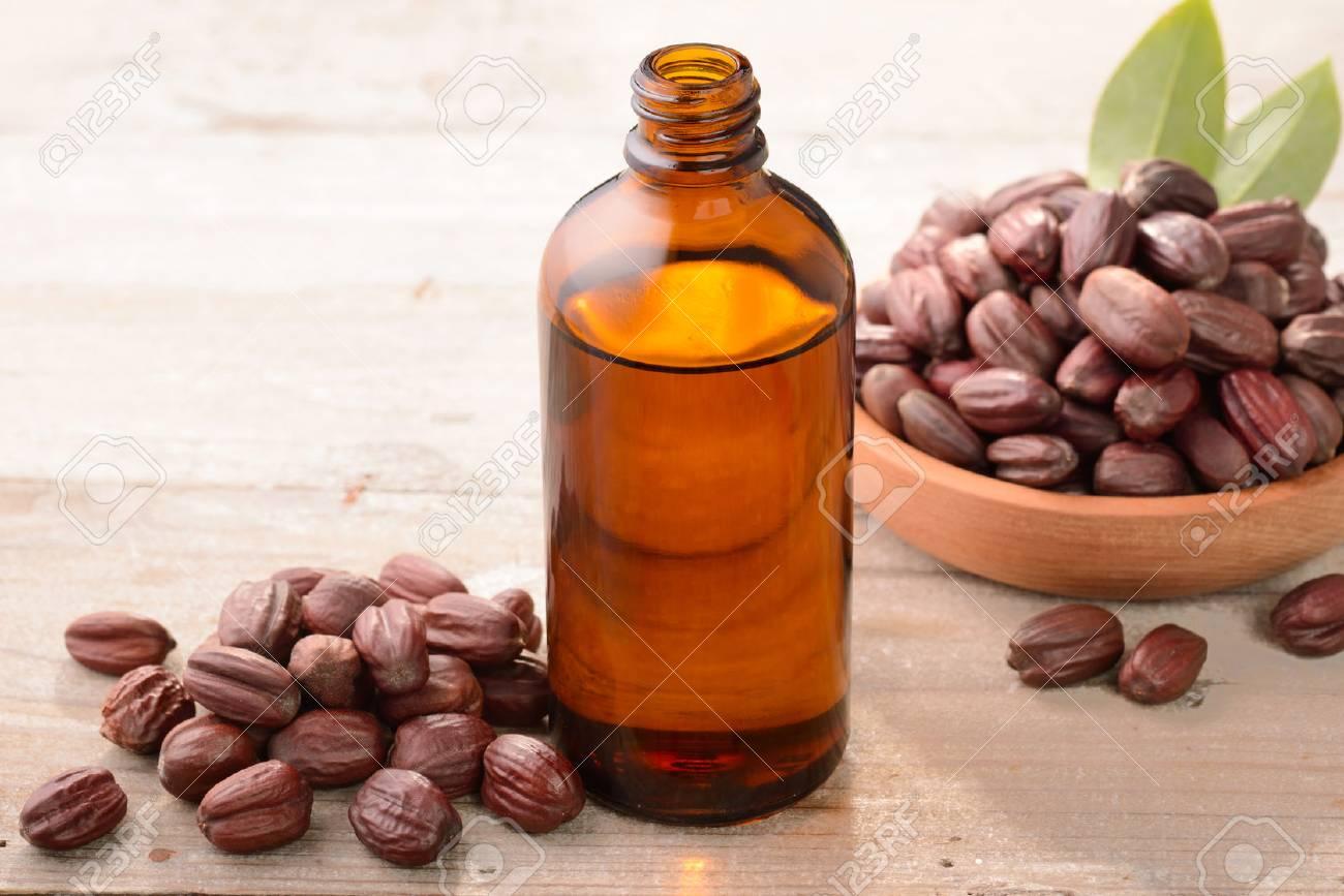 Jojoba oil on the wooden board - 87114051