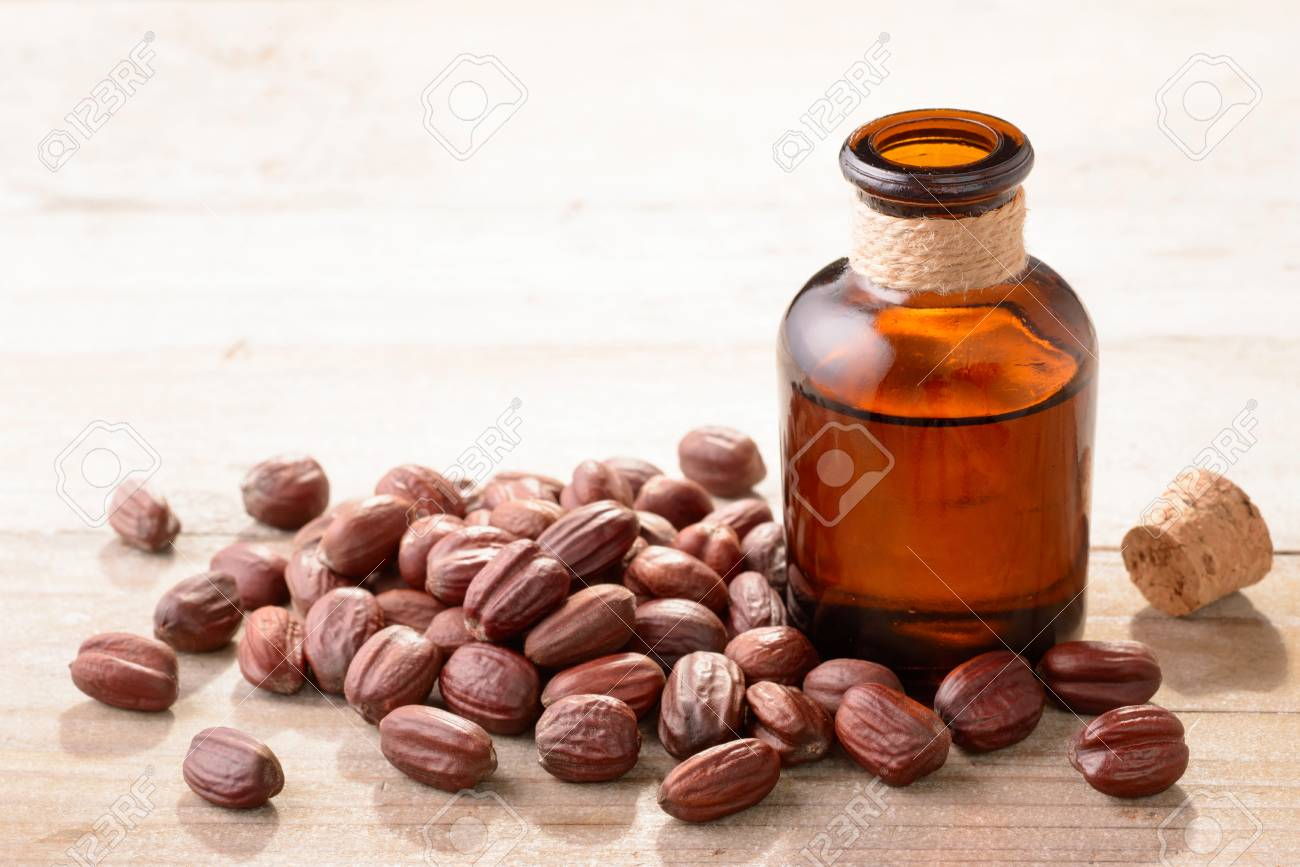 Jojoba oil in the glass bottle - 87275530