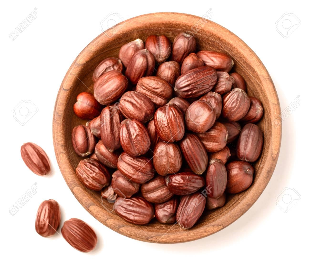dried jojoba seeds isolated on white - 87751317
