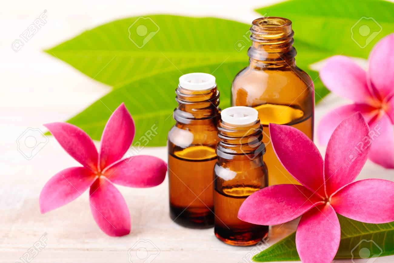 Plumeria Fragrance Oil Perfume And Red Plumeria Flowers On The