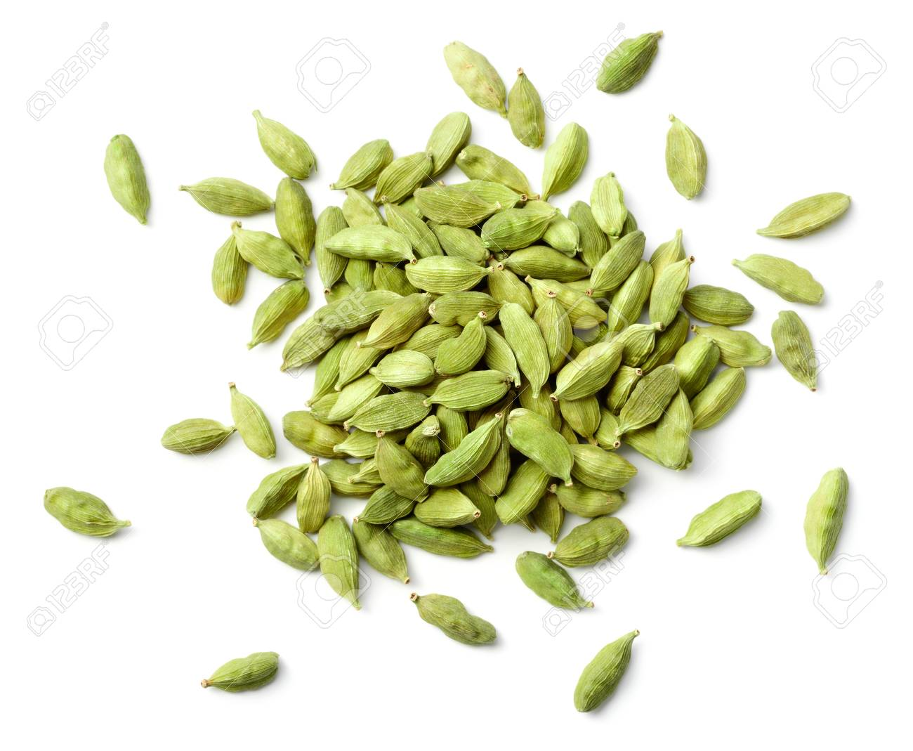 closeup of dried cardamom isolated on white - 95358438