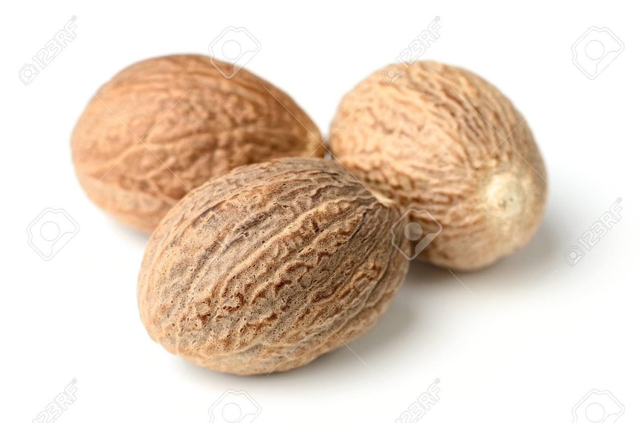 closeup of nutmeg spice isolated on white - 102232292