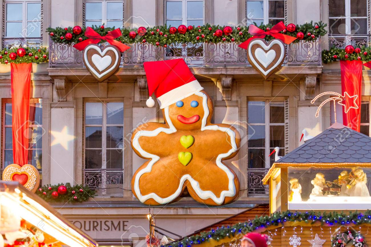 Giant Gingerbread Man Decoration Attached To A Facade On A Public