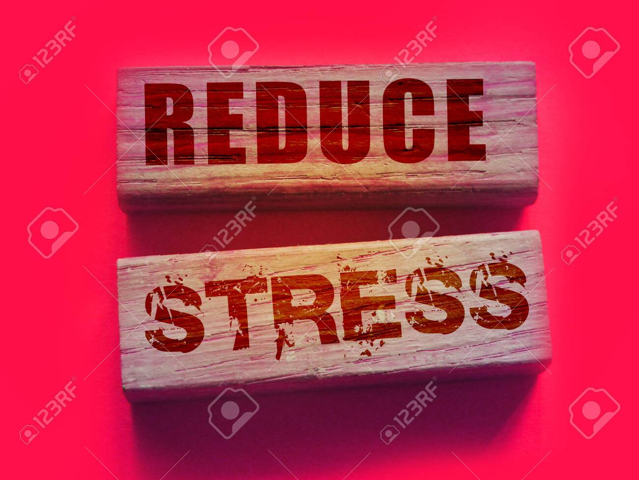 Reduce Stress text on wooden blocks on vivid pink. Calm relax health concept. - 142839584