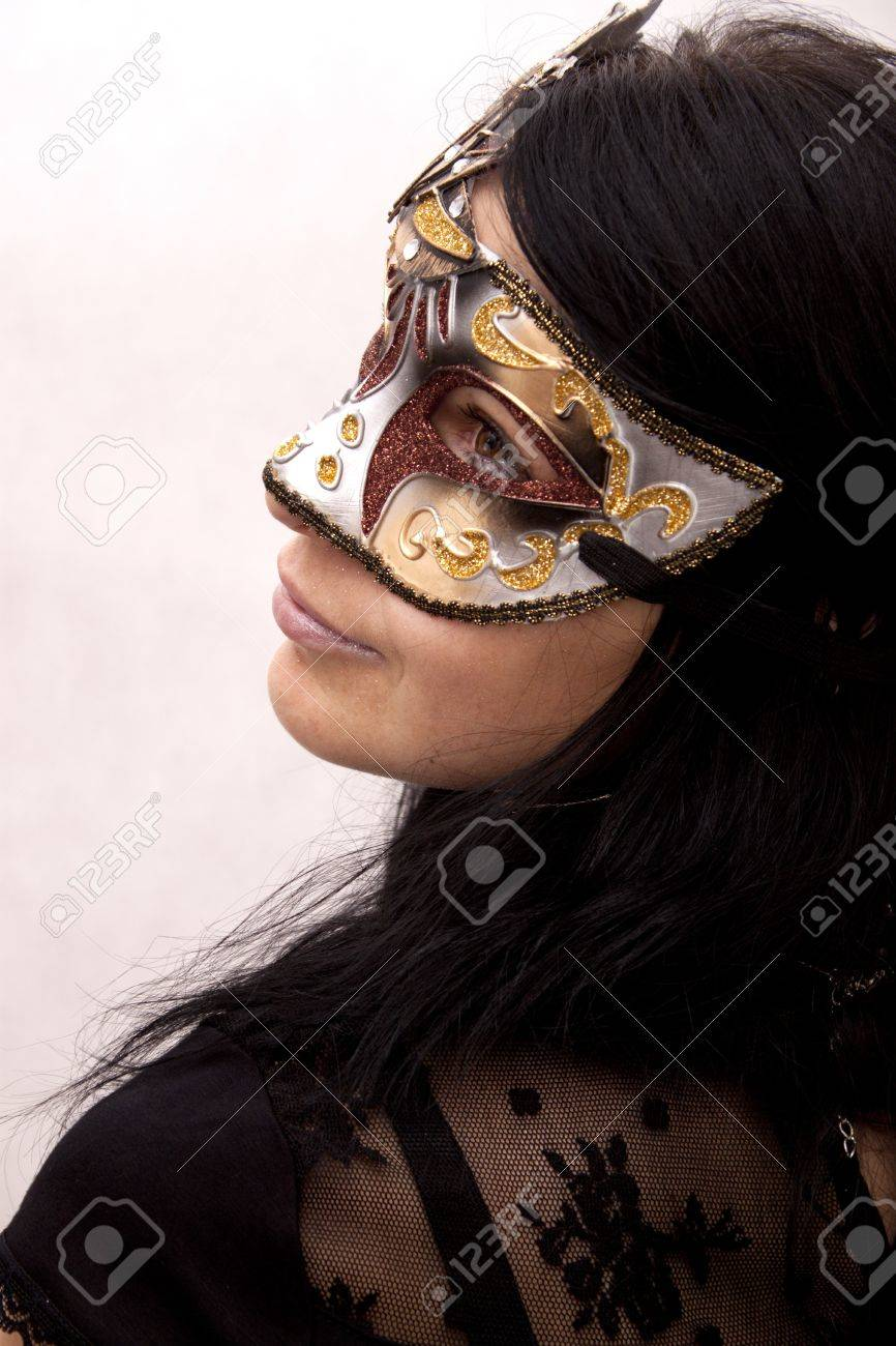 Sexy woman in venetian mask on a white background Stock Photo - 13562955