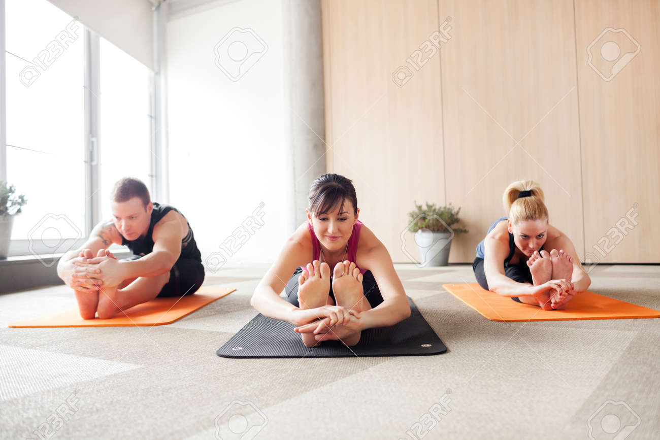 Three People In A Yoga Class Holding A Pose Stock Photo Picture And Royalty Free Image Image 39449136