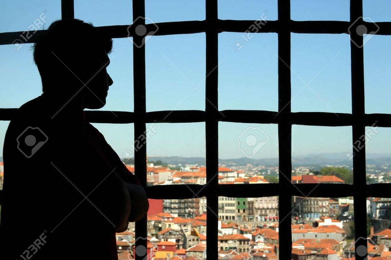 man behind bars Stock Photo - 728180