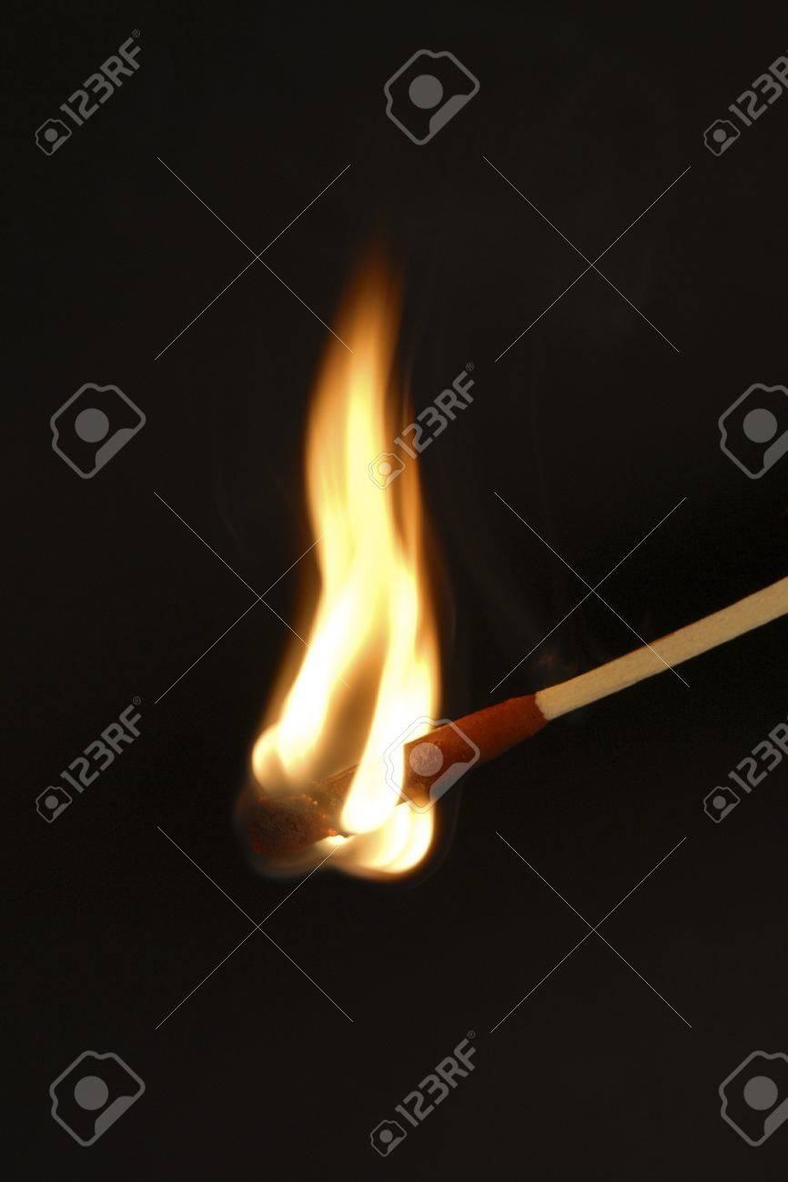Burning match against black background Stock Photo - 9900006