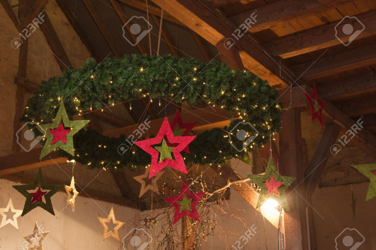 Hanging Christmas Decorations Ceiling.Christmas Wreath Hanging From Wooden Barn Ceiling