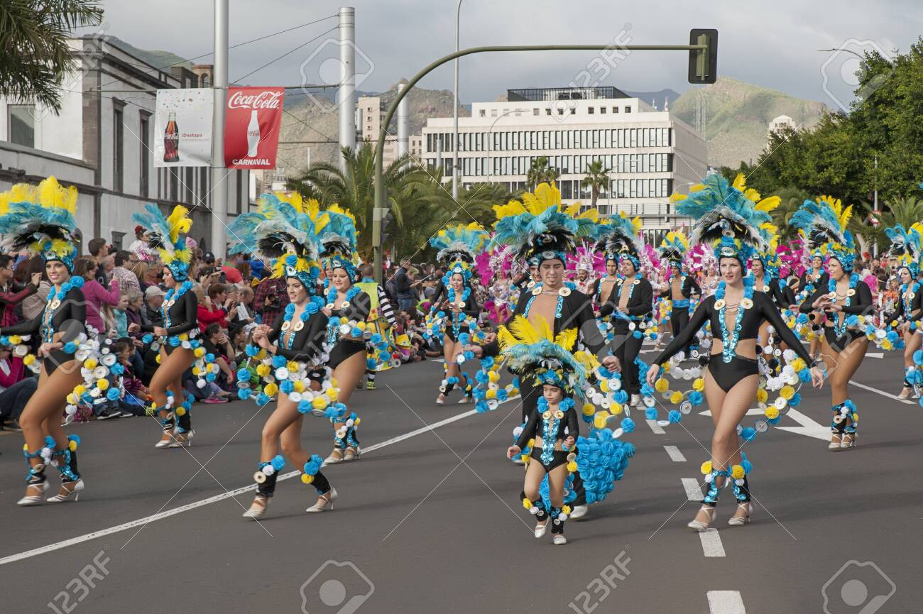 Carnival Santa Cruz de Tenerife, Canary Islands, Spain - February 17, 2015: costumed participants dancing, marching and announcing the beginning of the popular event held yearly in spring in Tenerife - 140699098