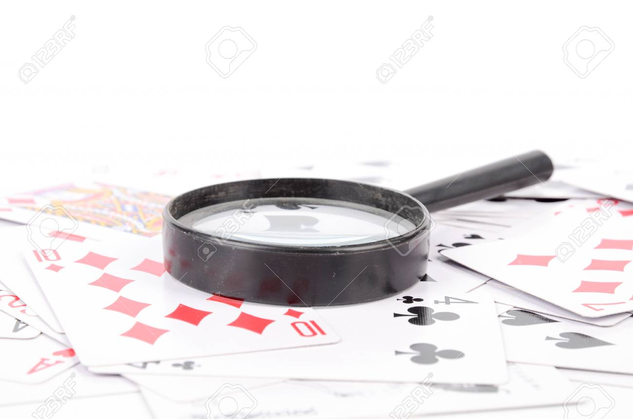 Magnifier and poker Stock Photo - 12875265