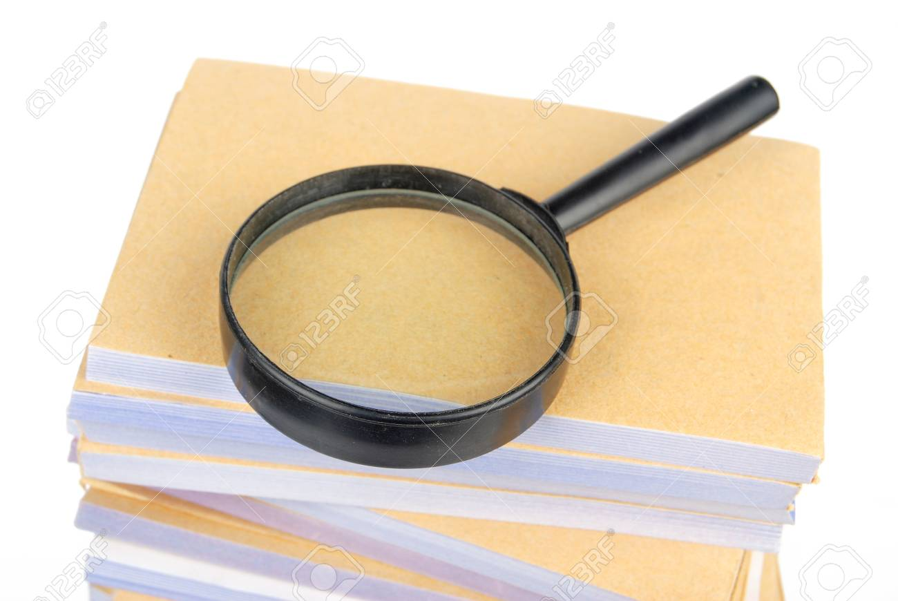 Documents and magnifier Stock Photo - 13137392