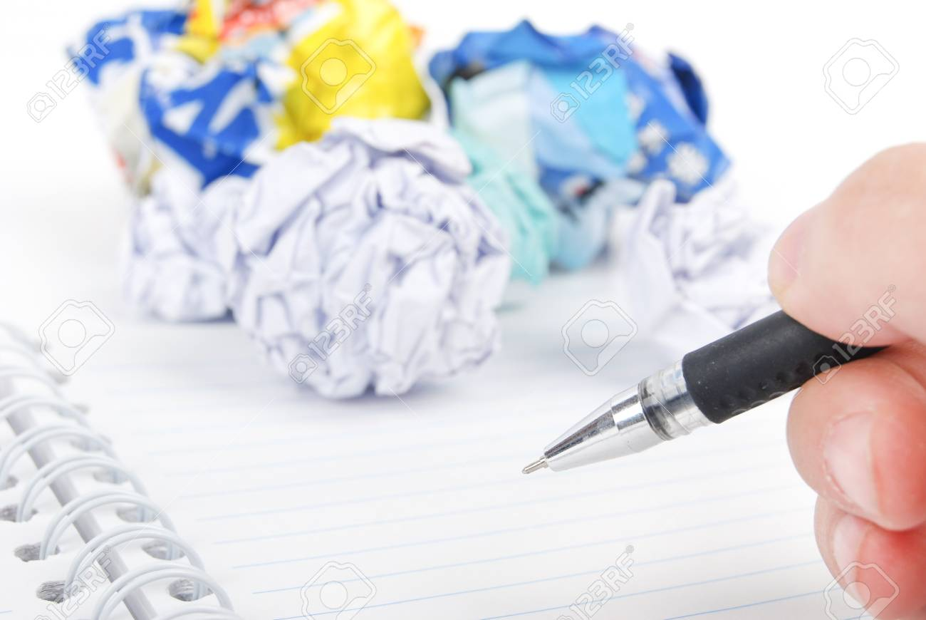 Crumpled paper ball and notepad with pen Stock Photo - 13492712