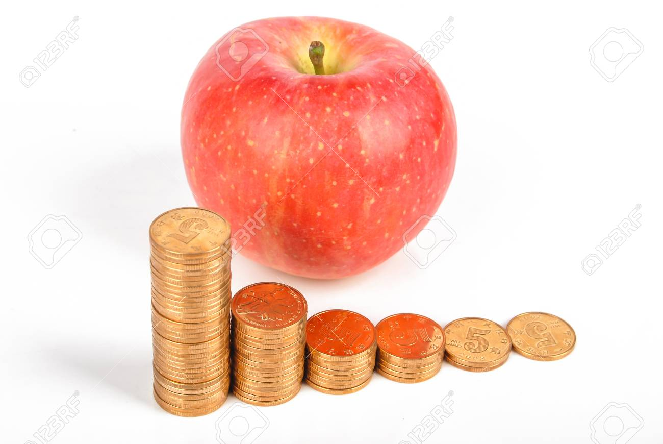 Apple and coins on white background Stock Photo - 13581721