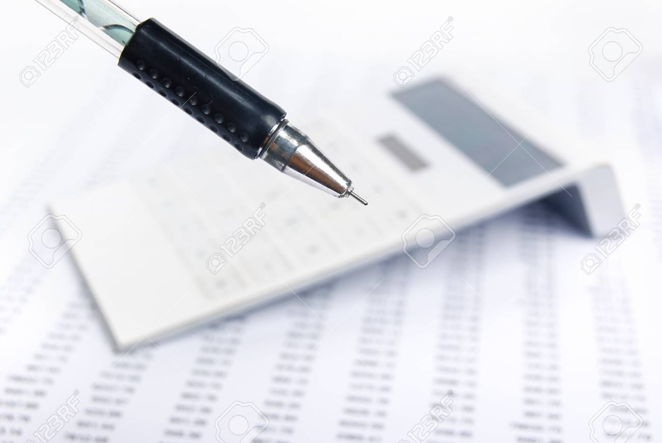 Financial statement with calculator and pen Stock Photo - 13752442
