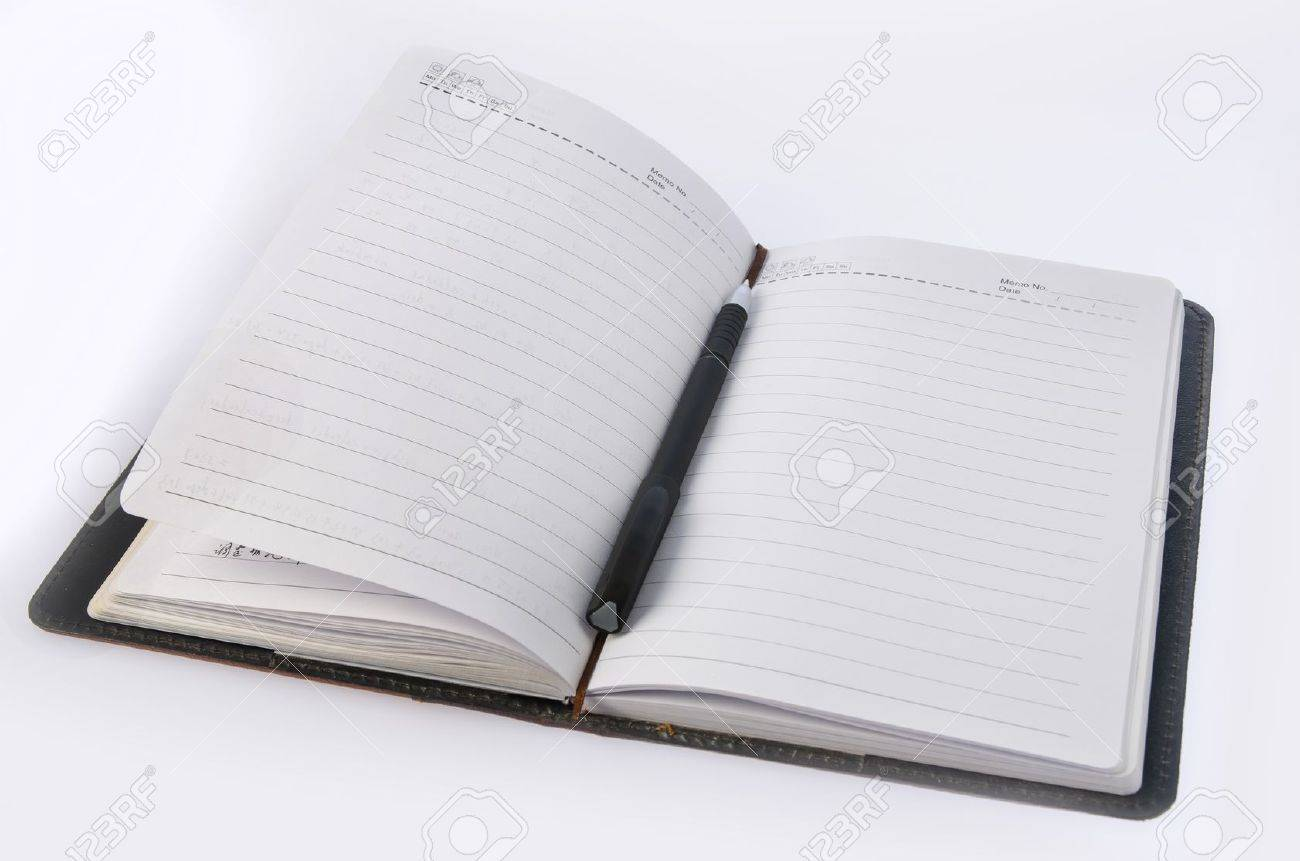 Notebook and pen on white background Stock Photo - 17225689