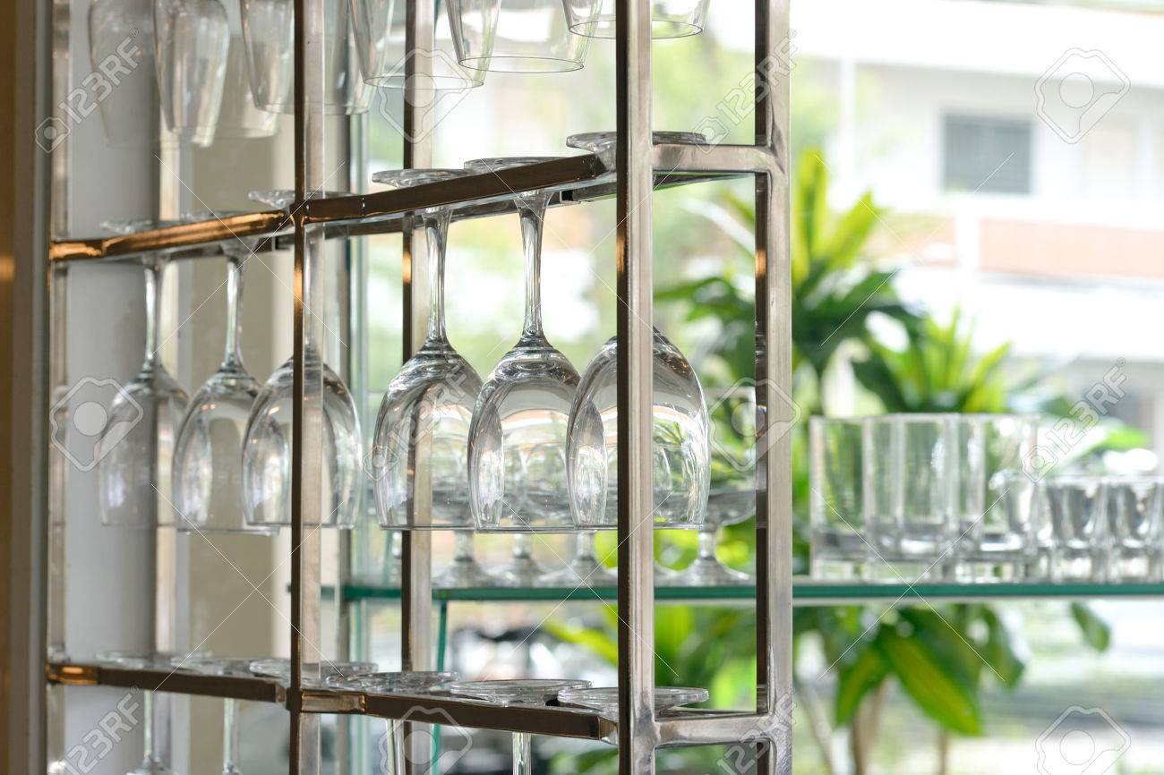 Closeup of a kitchen with glass shelf and drinking glasses
