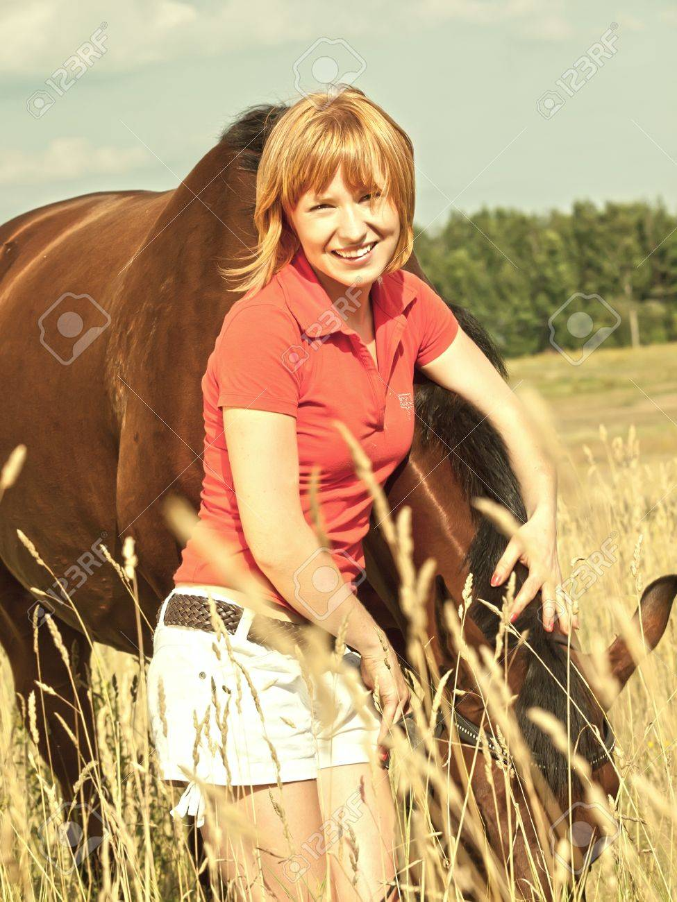 young girl  with her horse in field Stock Photo - 10291071