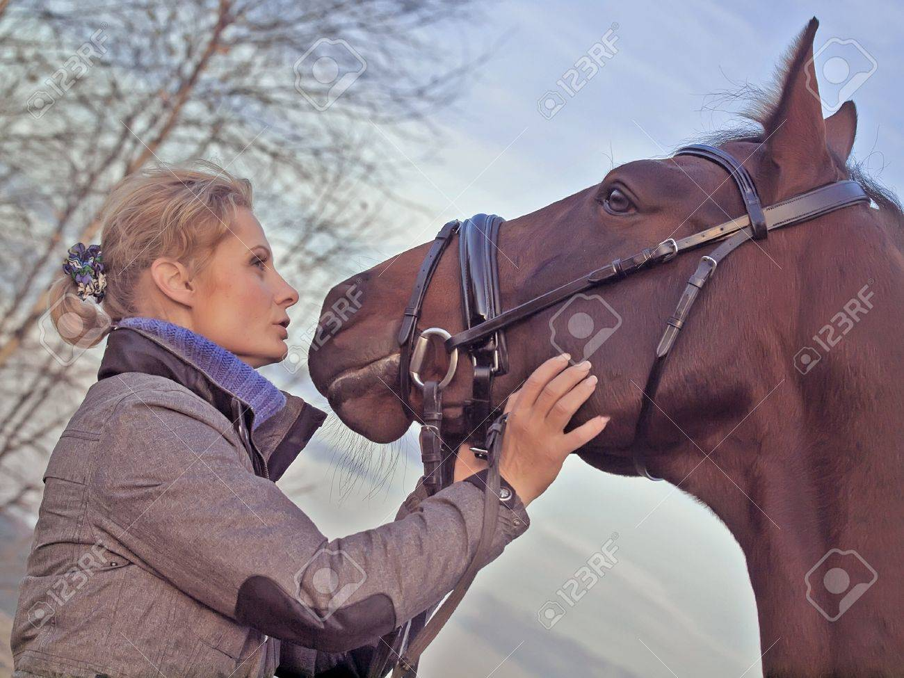 women with her horse at fall evening Stock Photo - 11218269