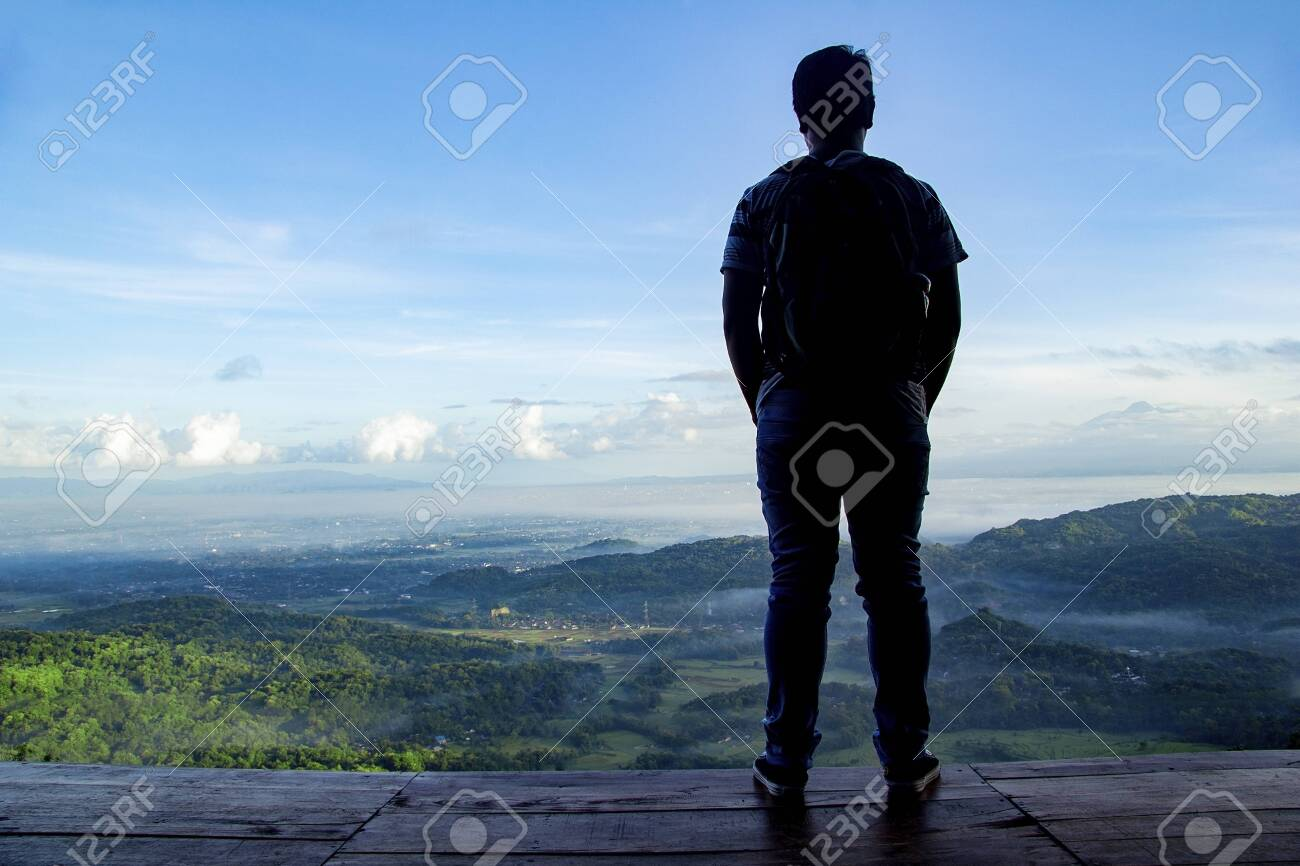 beautiful landscape view from Becici Pine Peak on yogyakarta, lonely man stand up in wooden floor with beautiful view - 120636873
