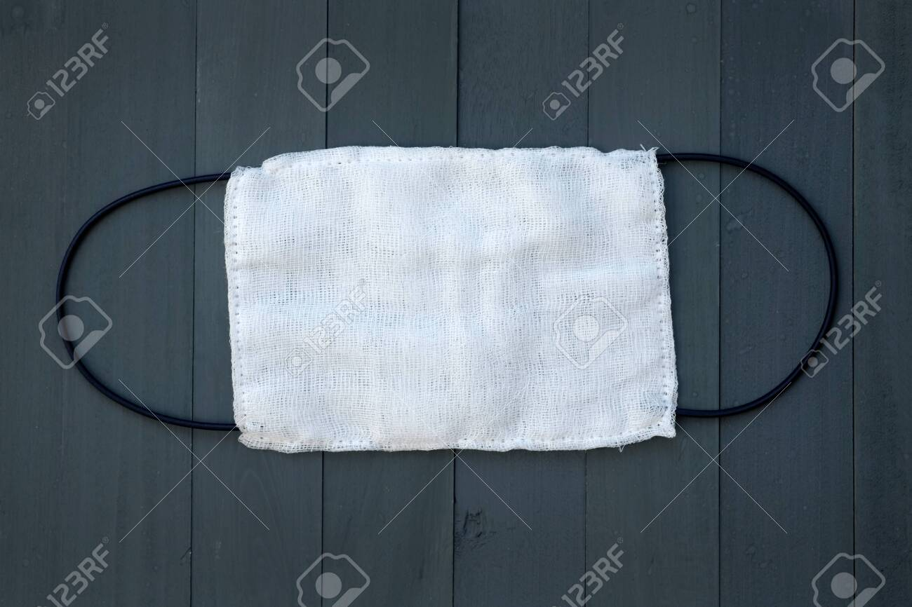 Gauze Mask For The Face With Black Elastic Bands Top View Hand