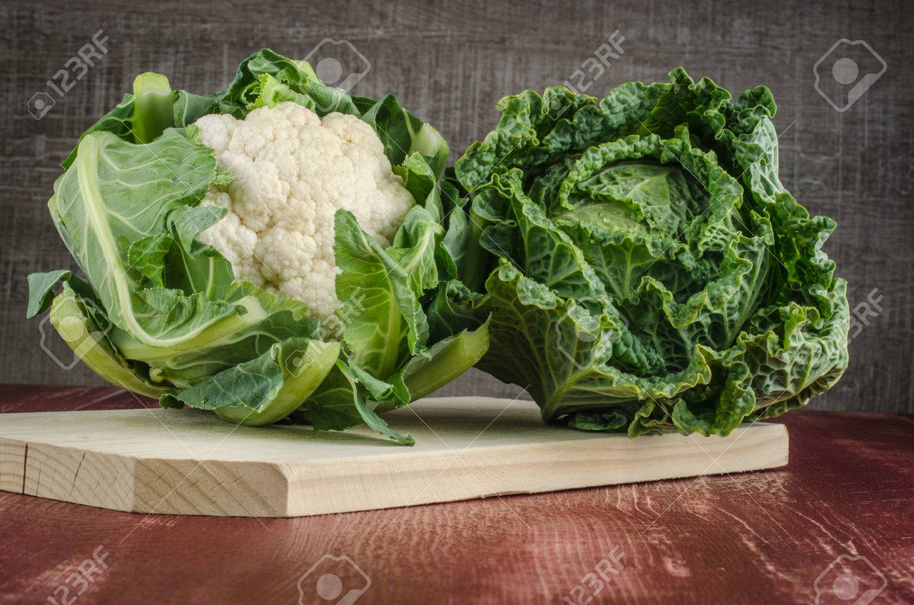 Assortment of fresh cabbages on brown background - 31826340