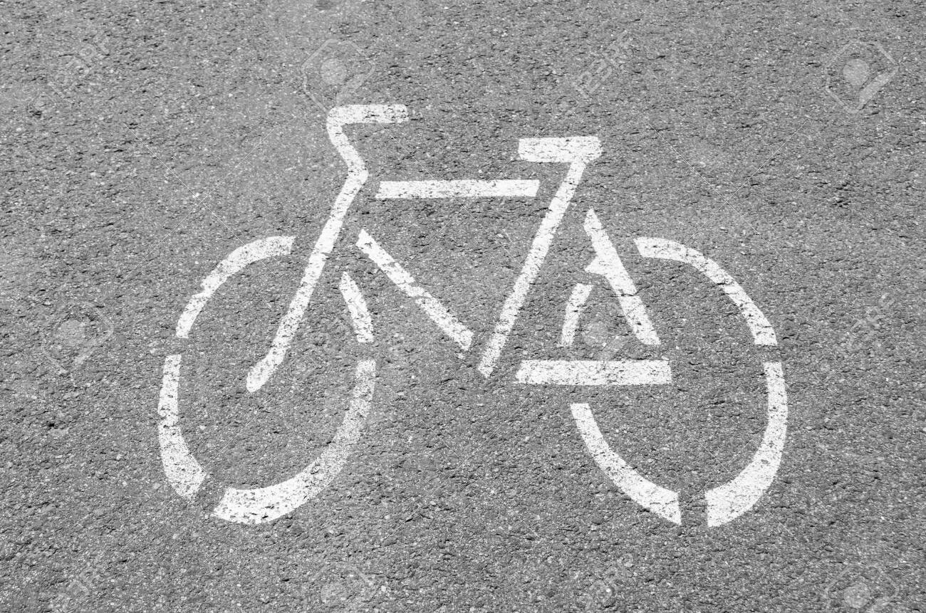 Bike lane. Road sign Bicycle on road. Bike path. Print on the pavement. The concept of health and sports. - 128166665