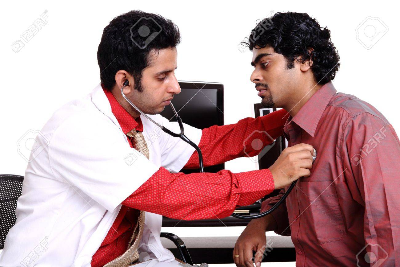 Indian young doctor examining patient Stock Photo - 12223691