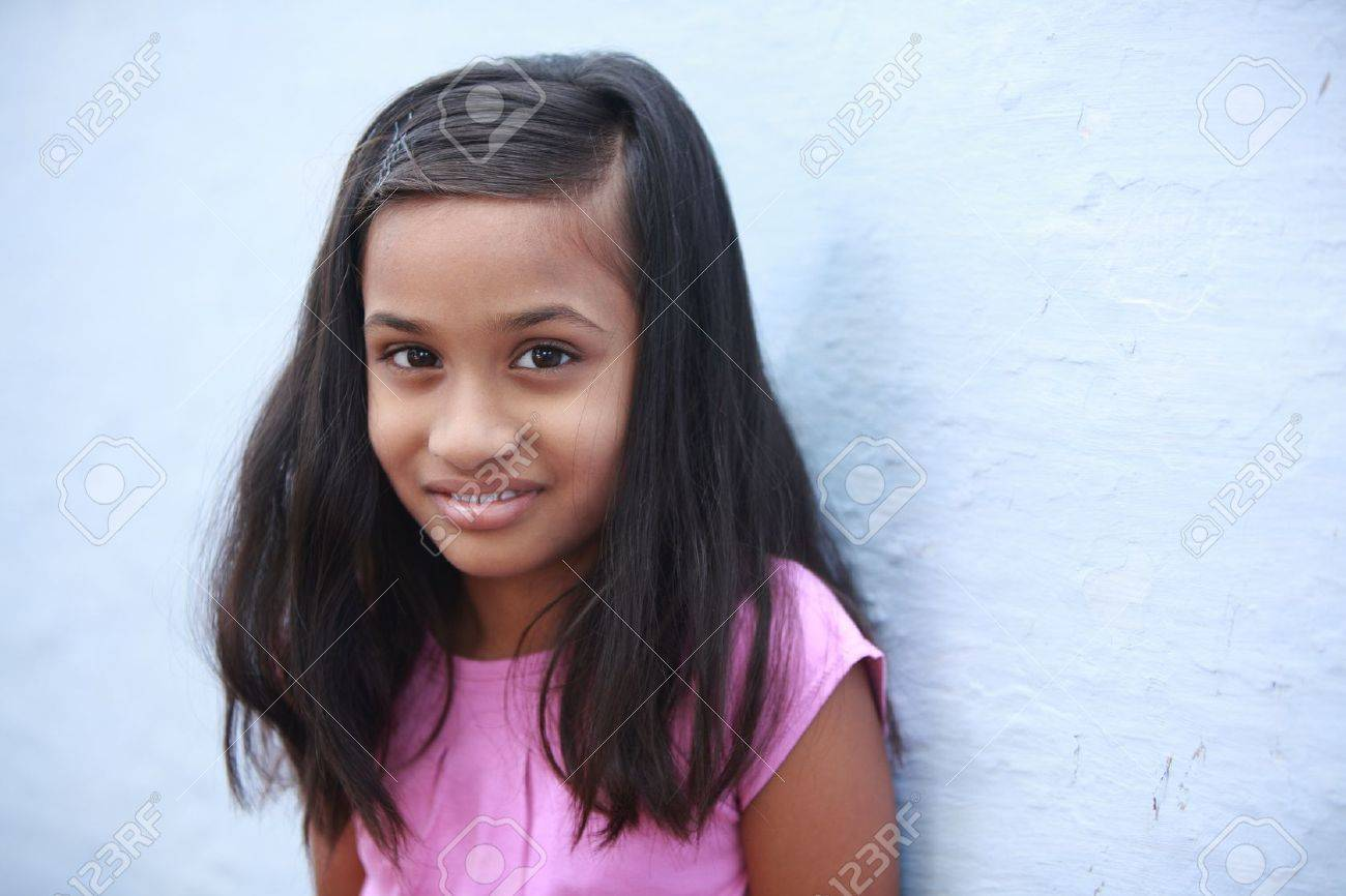 Beautiful Indian little girl posing to the camera. Stock Photo - 12334501