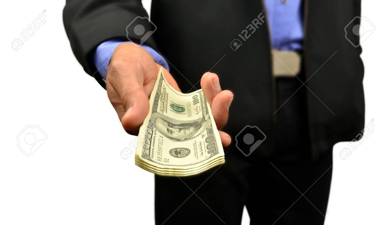 business man holding money in hand Stock Photo - 10082993