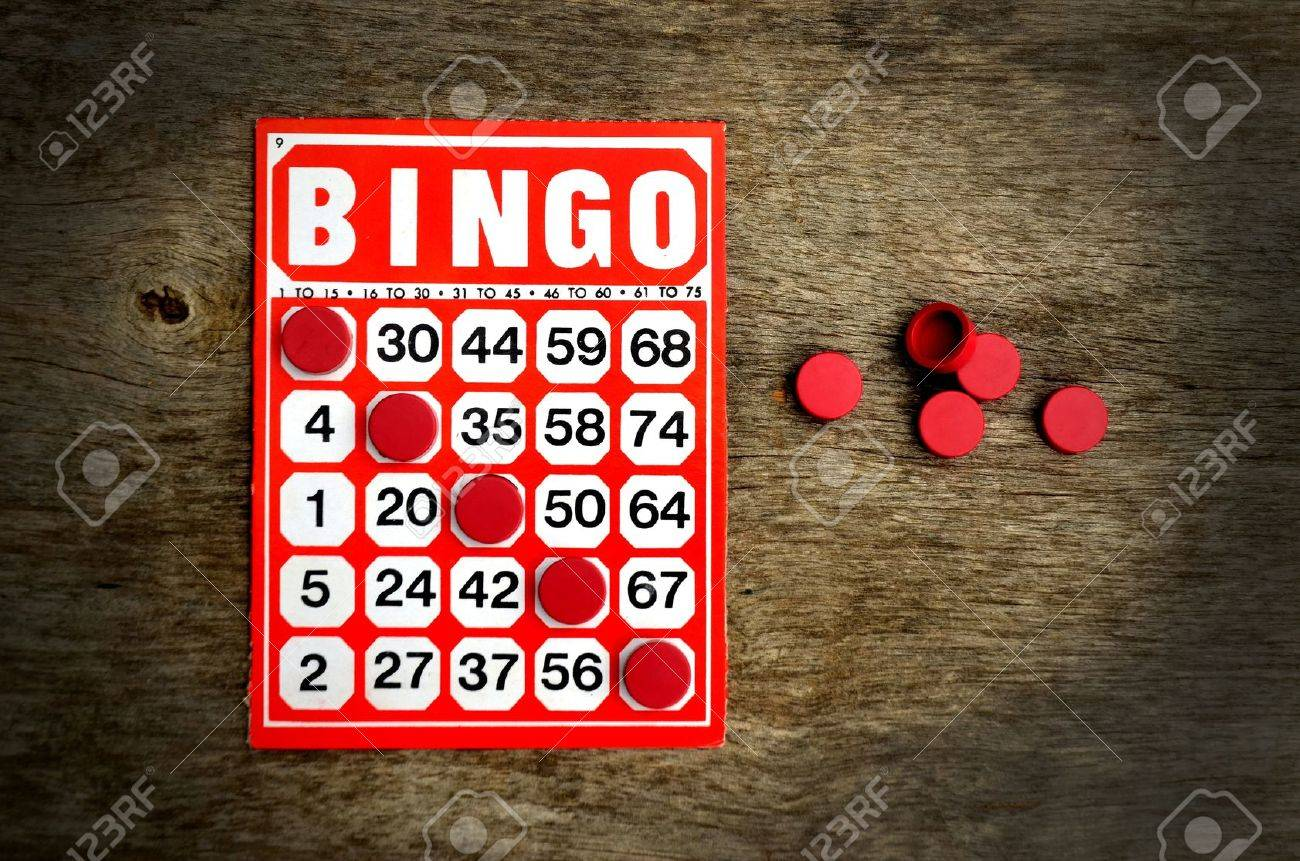 Red bingo card with winning chips Stock Photo - 10481649