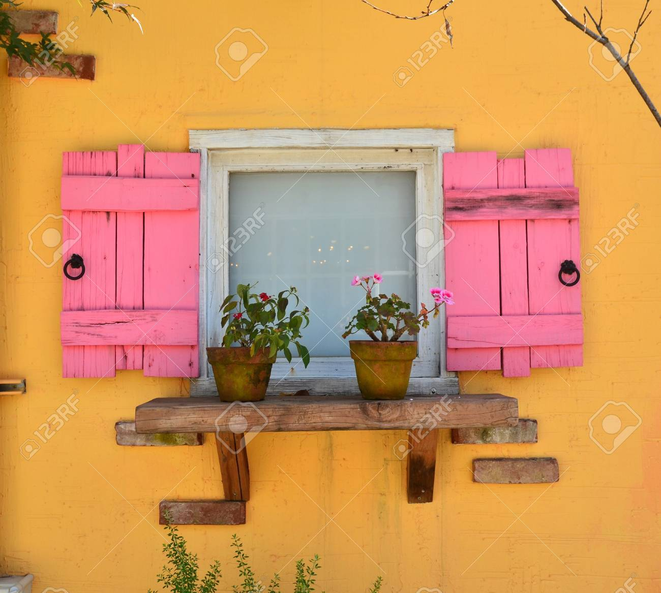 old open window and yellow wall Stock Photo - 10987681