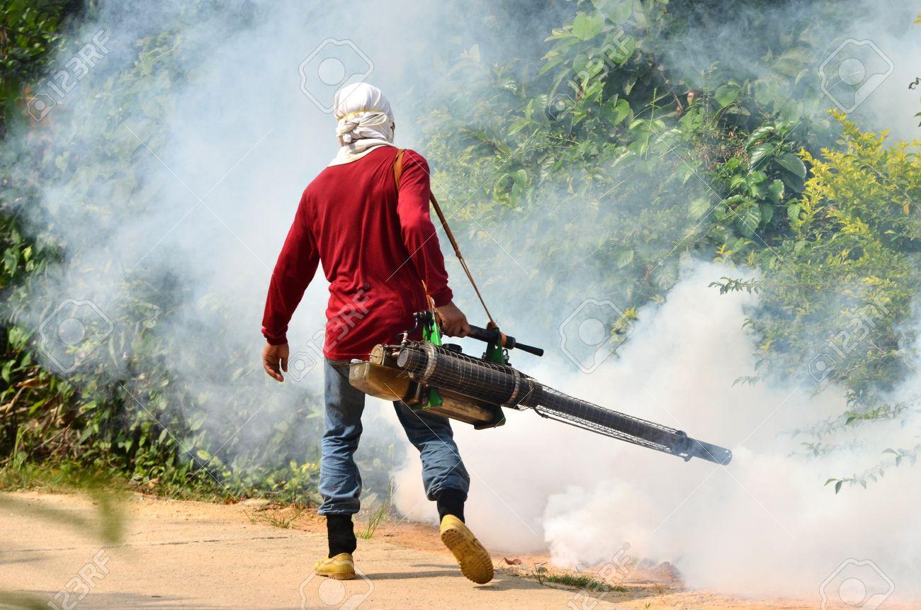 man Fogging to prevent spread of dengue fever in thailand Stock Photo - 13744067