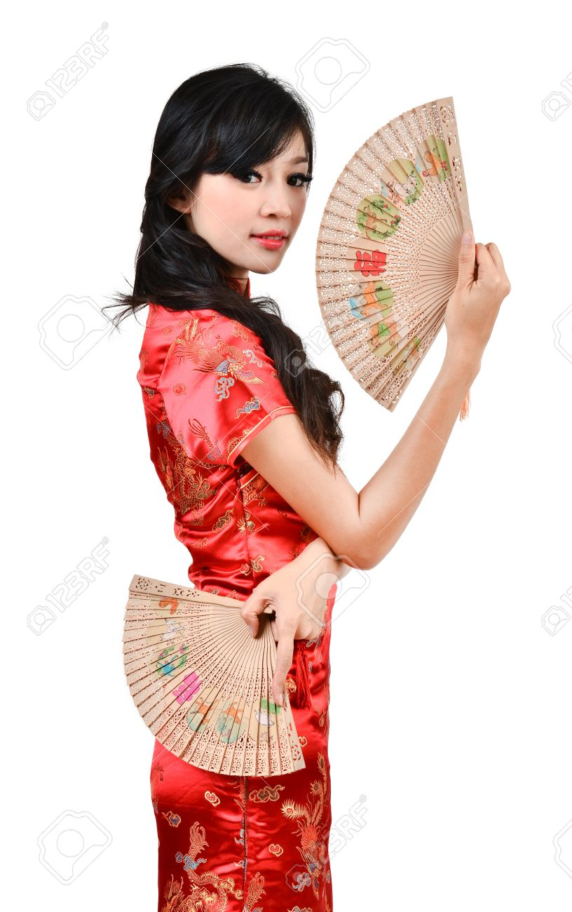 c8c4ffa04 pretty women with Chinese traditional dress Cheongsam and hole Chinese Fan  on white background Stock Photo