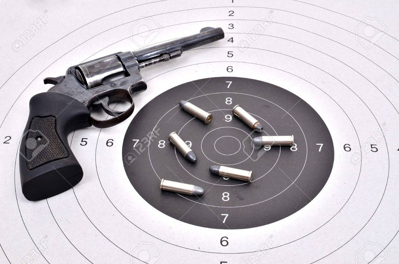 old revolver gun with bullet on the target Stock Photo - 18684143