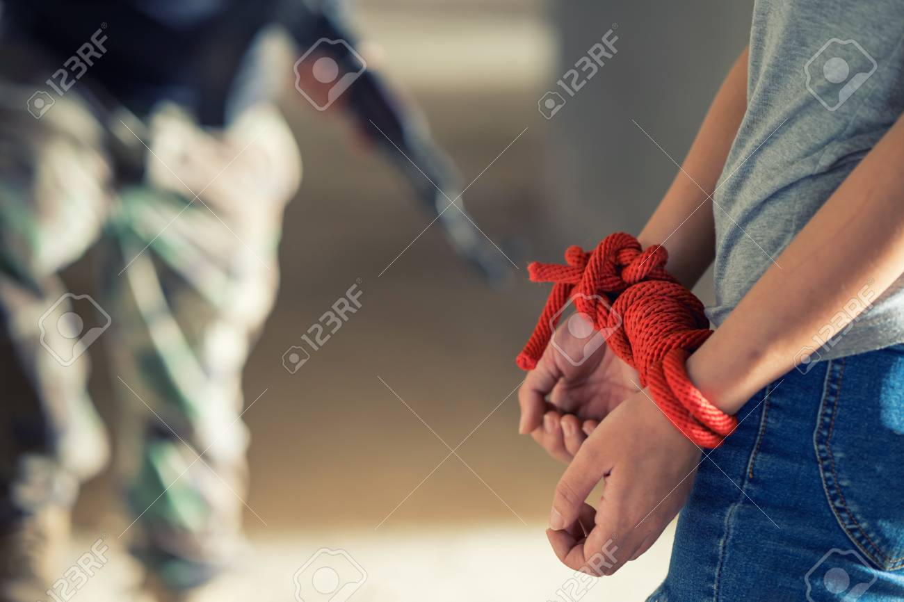 Tied rope hands of abused woman, human trafficking Stock Photo - 73525688