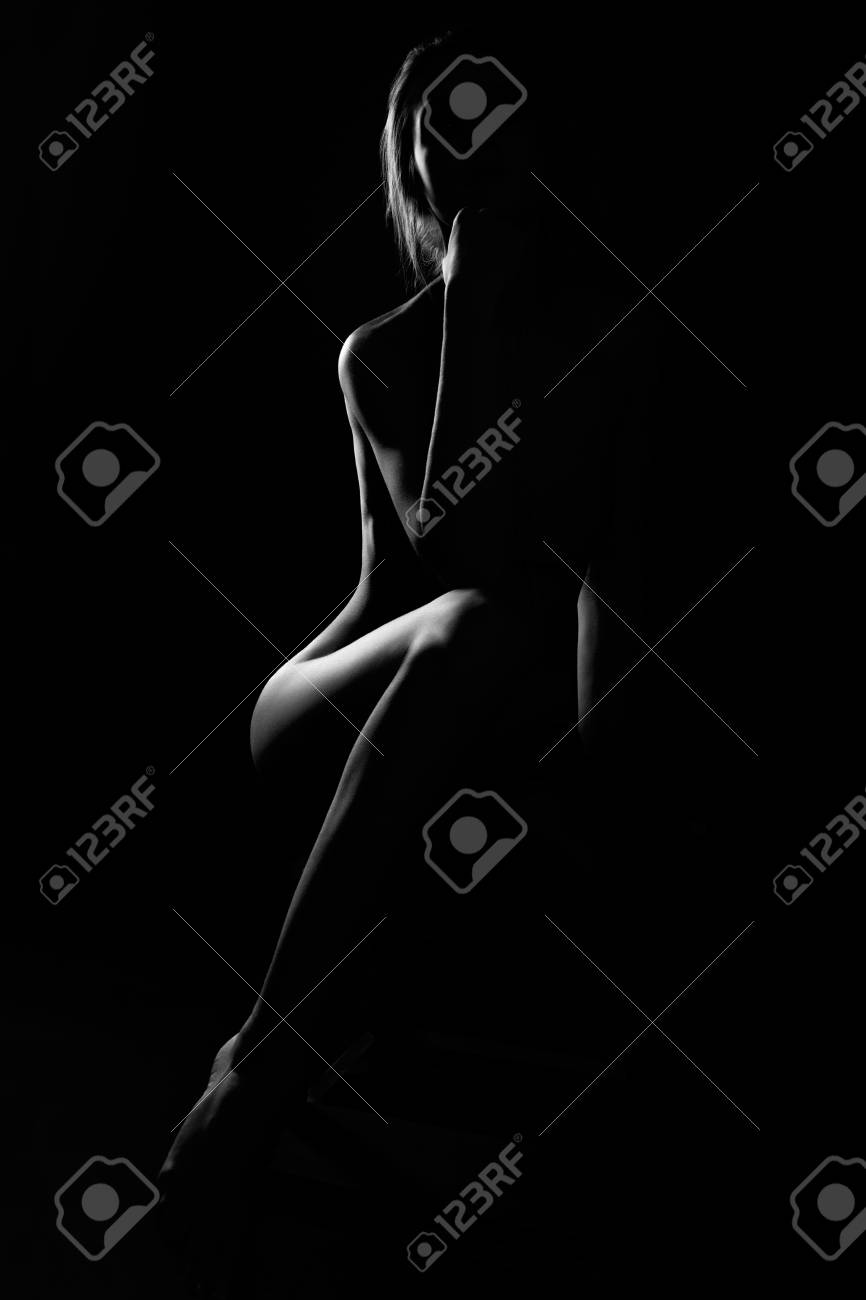Black and white female body in back light art photography stock photo 97062692