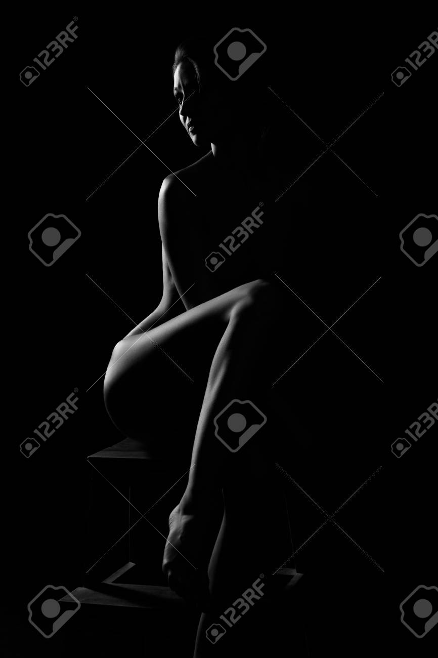 Black and white female body in back light art photography
