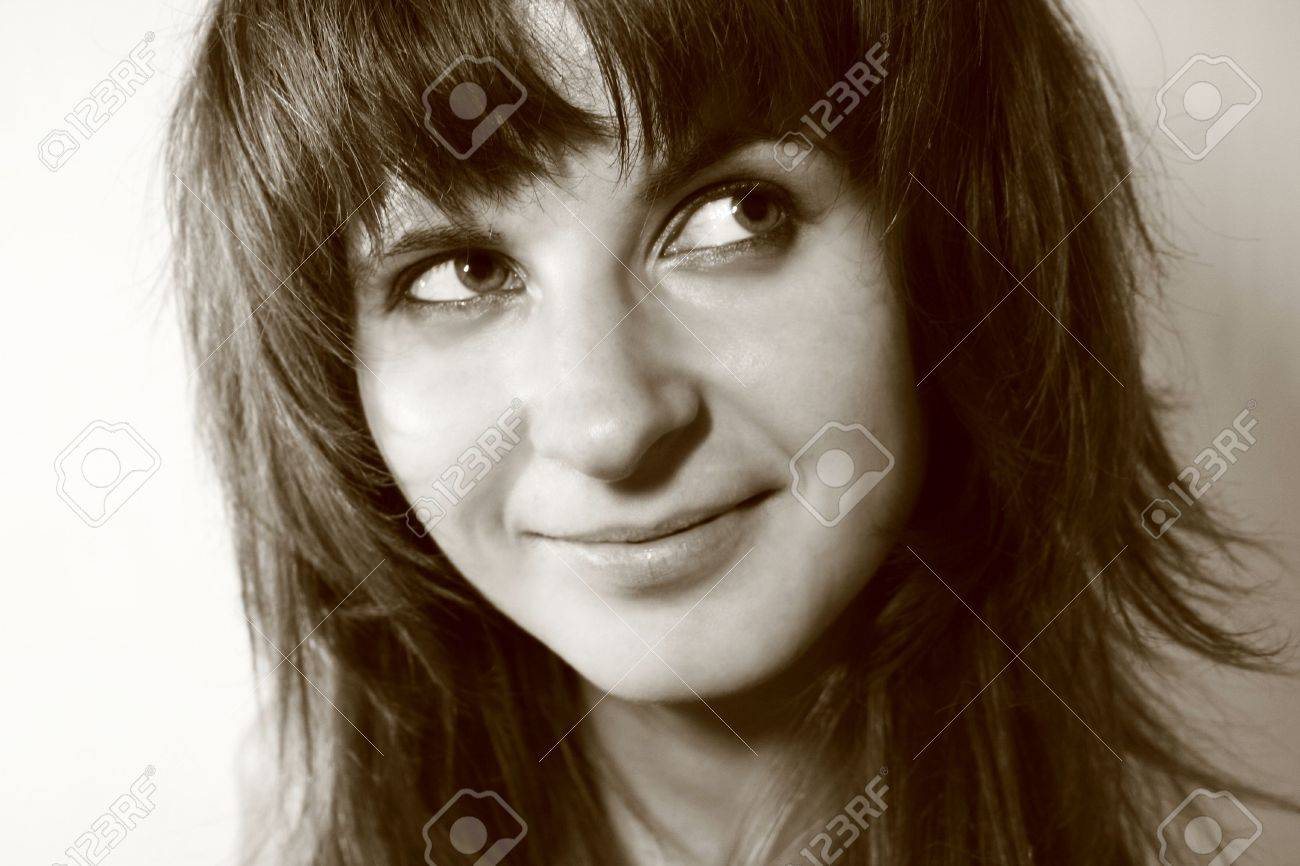 Young woman smiling while looking away Stock Photo - 1878190