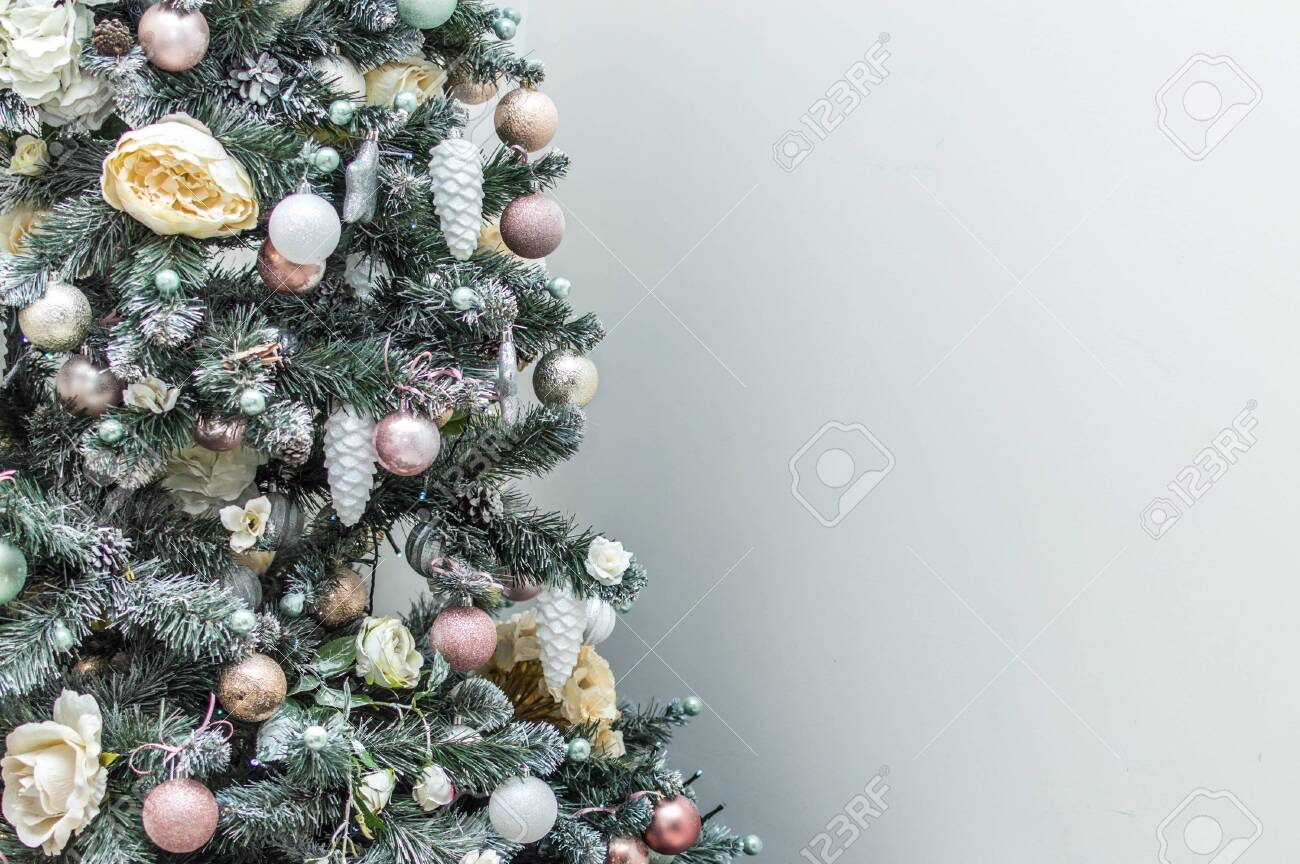 Christmas tree with Christmas decorations on a gray background