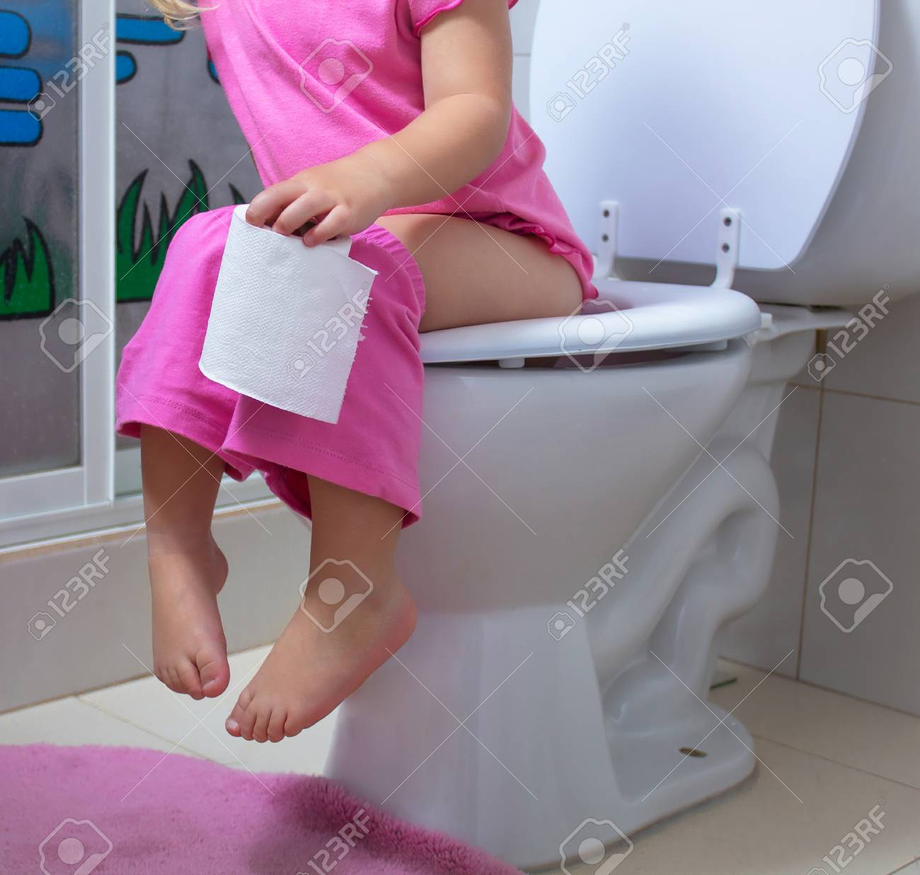 Little Girl Using A Bathroom Stock Photo Picture And Royalty Free Image Image 105272676