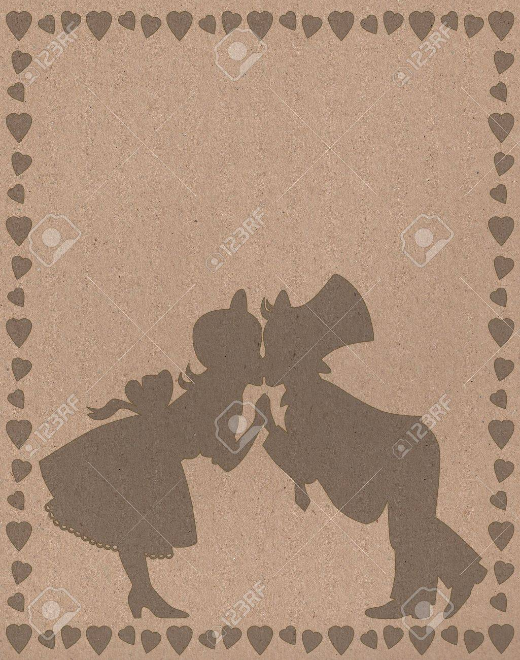 dark silhouette of kissing a boy and a girl in a frame of hearts Stock Photo - 17088482